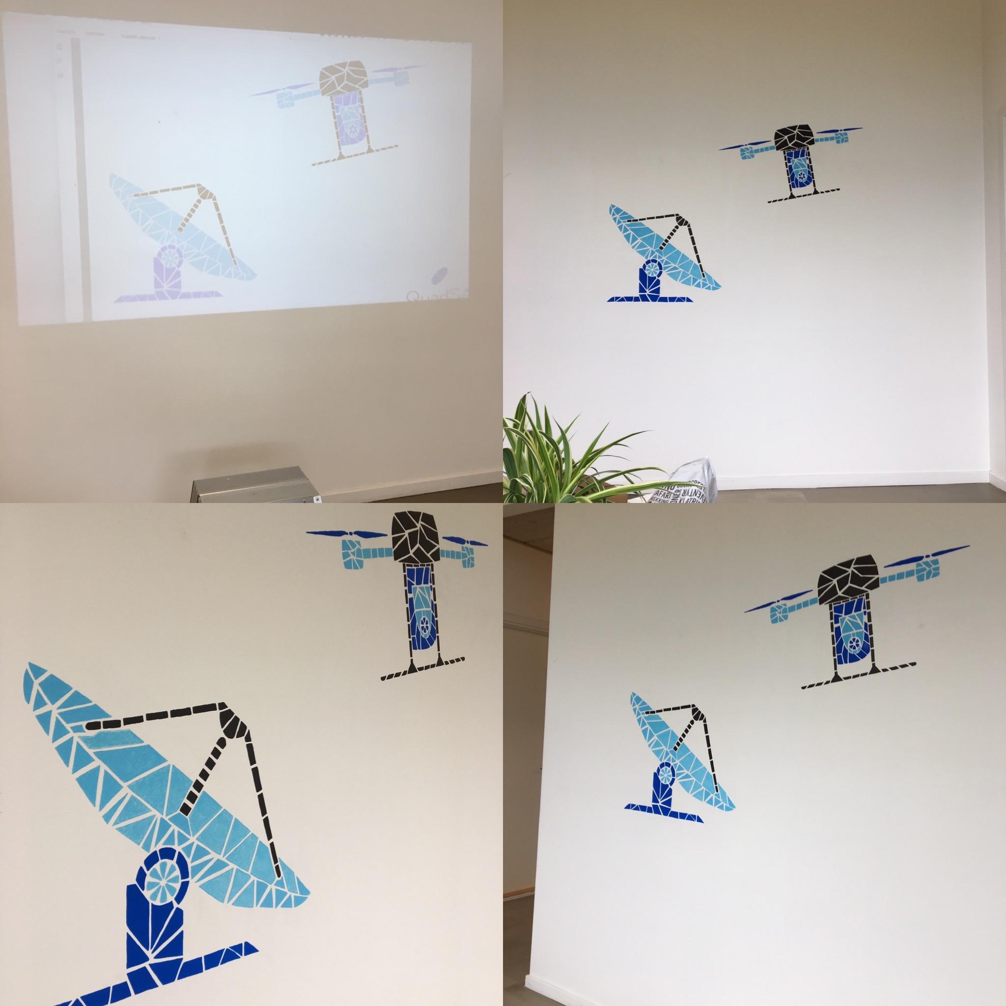 Vægdekoration af en antenne og drone designet af mange små trekanter.