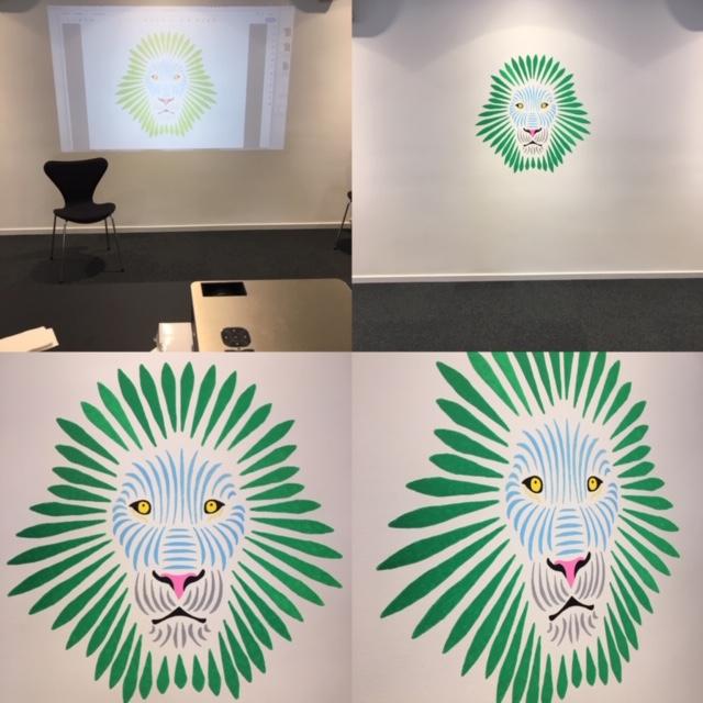 Vægdekoration af et abstrakt løvehoved til Jyske Bank.